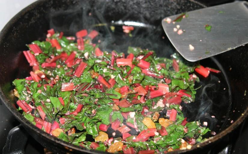 Sauteed Dark Leafy Greens with Pine Nuts., Garlic, andRaisins